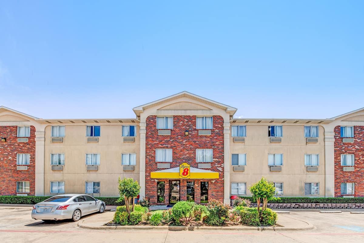 Exterior Of Super 8 Mckinney Plano Area Hotel In Texas
